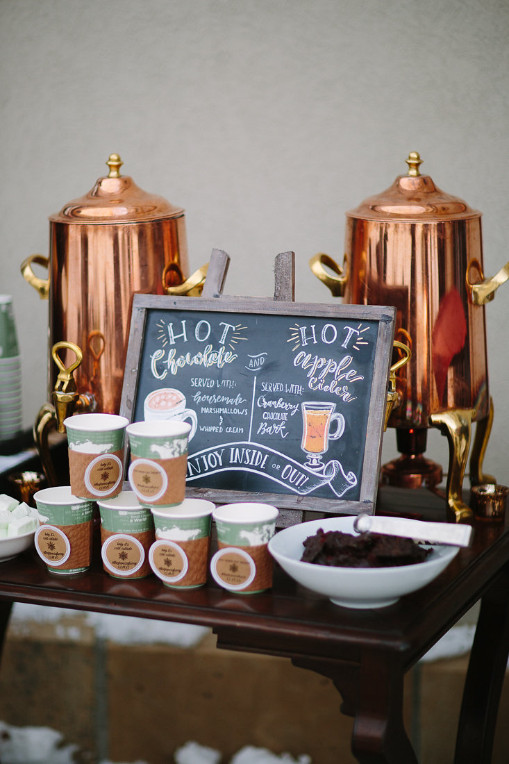 Hot chocolate and cider bar for guests to enjoy at the ceremony.
